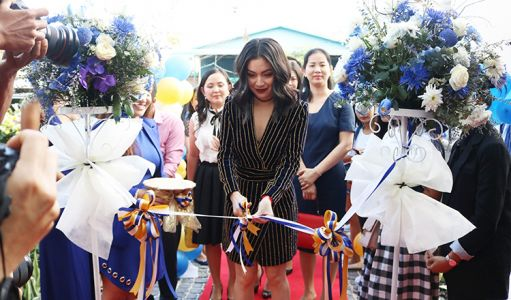 Lok Chumteav Yim Chai Lin at the ribbon cutting for the Amed Clinic Cambodia's grand opening.