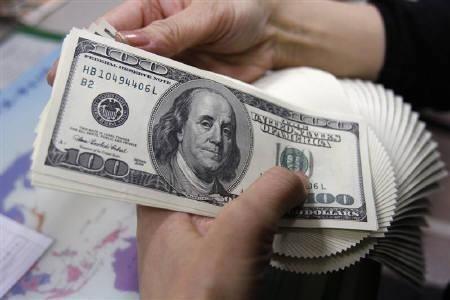 An Employee Of Money Exchange Counts U S Dollar Bills In Tokyo Photo Reuters