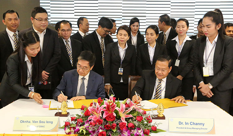 Acleda, GMAC in garment workers payroll system deal - Khmer