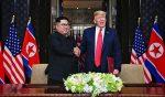 Kim Jong Un (left) shakes hands with US President Donald Trump