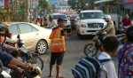 Voluntees-directed-traffic-on-Phnom-Penh-'s-street-,-CHOR3749